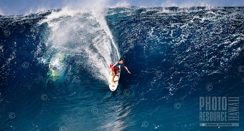 Surfer on a perfect day at Banzai Pipeline on North Shore of Oahu.