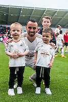 Leon Britton of Swansea City  on the pitch with team players and staff during a lap of honour after the Barclays Premier League match between Swansea City and Manchester City played at the Liberty Stadium, Swansea on the 15th of May  2016