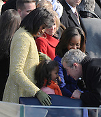 Washington, DC - January 20, 2009 -- Former United States President George W. Bush greets Sasha Obama as sister Malia and mom Michelle looks on as he arrives for the inauguration of Barack Obama as the 44th President of the United States on the west steps of the Capitol on Tuesday, January 20, 2009.  Former President Bush left a short time later in a helicopter. .Credit: Pat Benic - Pool via CNP