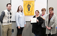 Courtesy photo<br /> Christina Allen (center) is congratulated and honored by Aaron Divine, Crowder McDonald County director (left); Julie DeNisco, adult education director; Shandra Stephens, Crowder McDonald County evening adminstrative assistant; and Maribeth Rakes, adult education instructor.
