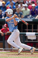 North Carolina shortstop Landon Lassiter (12) follows through on his swing during Game 3 of the 2013 Men's College World Series against the North Carolina State Wolfpack at TD Ameritrade Park on June 16, 2013 in Omaha, Nebraska. The Wolfpack defeated the Tar Heels 8-1. (Andrew Woolley/Four Seam Images)