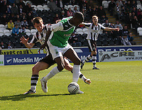 isaiah Osbourne under presure from Paul McGowan in the St Mirren v Hibernian Clydesdale Bank Scottish Premier League match played at St Mirren Park, Paisley on 29.4.12.