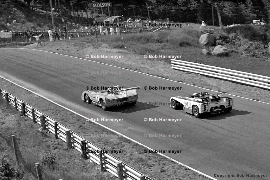 Peter Revson (#7 McLaren-Chevrolet) leads Jackie Stewart (#1 Lola-Chevrolet) in the 1971 SCCA Can-Am race at Le Circuit Mont Tremblant/St. Jovite, Quebec, Canada.