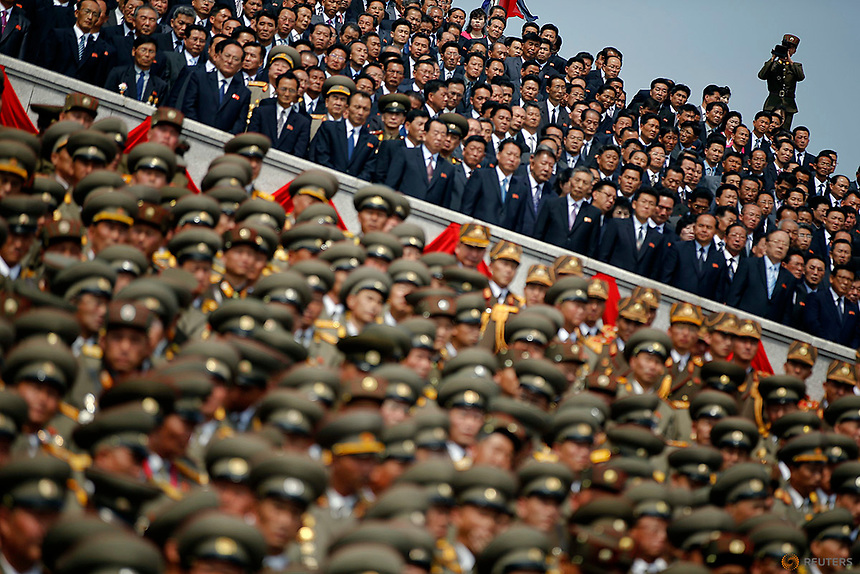 A soldier films North Korean soldiers, officers and high ranking officials  attending a military parade marking the 105th birth anniversary of country's founding father, Kim Il Sung in Pyongyang, North Korea April 15, 2017.    REUTERS/Damir Sagolj