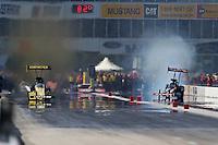 Apr. 28, 2013; Baytown, TX, USA: NHRA top fuel dragster driver Morgan Lucas (left) races alongside Steve Torrence during the Spring Nationals at Royal Purple Raceway. Mandatory Credit: Mark J. Rebilas-