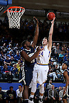 BROOKINGS, SD - FEBRUARY 4:  Mike Daum #24 from South Dakota State University shoots a short hook shoot over Albert Owens #44 from Oral Roberts during their game Saturday afternoon at Frost Arena in Brookings.(Photo by Dave Eggen/Inertia)