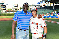 Lee Smith poses for a photo after throwing out the ceremonial first pitch with catcher Justin Cohen (17) of Riverview High School in Sarasota, Florida during the Under Armour All-American Game on August 16, 2014 at Wrigley Field in Chicago, Illinois.  (Mike Janes/Four Seam Images)