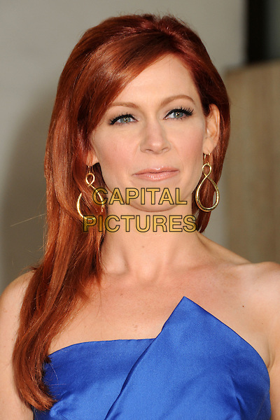 """CARRIE PRESTON.HBO's """"True Blood"""" Season 3 Premiere held at Arclight Cinemas Cinerama Dome, Hollywood, California, USA..June 8th, 2010.headshot portrait blue strapless dangling gold earrings folds origami .CAP/ADM/BP.©Byron Purvis/AdMedia/Capital Pictures."""