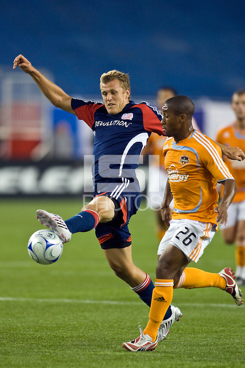 New England Revolution forward Adam Cristman (7) and Houston Dynamo midfielder Corey Ashe (26). The New England Revolution defeated the Houston Dynamo 2-2 (6-5) in penalty kicks in the SuperLiga finals at Gillette Stadium in Foxborough, MA, on August 5, 2008.