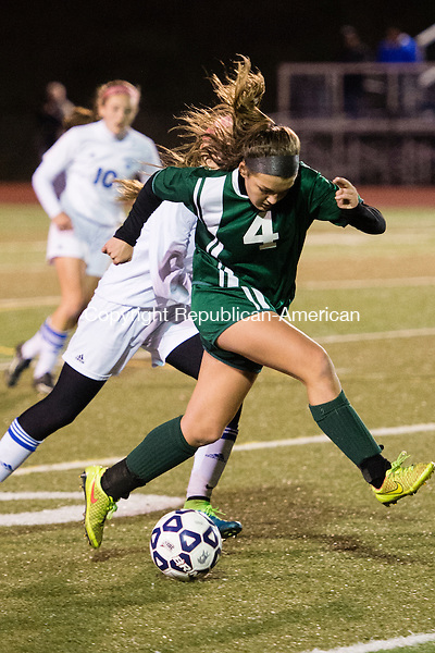 MIDDLETOWN, CT - 16 November 2015-111615EC06-- Holy Cross' Julia Sheetz controls the ball down the field against Old Lyme in Middletown Monday night. Erin Covey Republican-American.