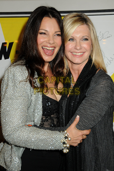 "FRAN DRESCHER & OLIVIA NEWTON-JOHN.""The Million Dollar Revival"" Benefit for Fran Drescher's Cancer Schmancer Charity Movement held at the Million Dollar Theatre, Los Angeles, California, USA..December 13th, 2009.half length black white grey gray jacket top smiling lace corset silver hug embrace pearl bracelet mouth open jewel encrusted embellished sparkly.CAP/ADM/BP.©Byron Purvis/AdMedia/Capital Pictures."