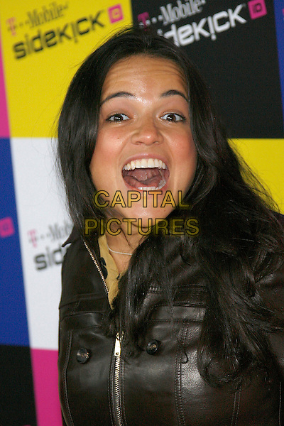 MICHELLE RODRIGUEZ.Attending the T-Mobile Sidekick iD Launch, .held at the T-Mobile Sidekick Lot,  Los Angeles, California, USA,13 April 2007..portrait headshot mouth open funny face.CAP/ADM/ZL.©Zach Lipp/AdMedia/Capital Pictures.