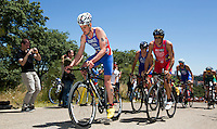 02 JUN 2013 - MADRID, ESP - Jonathan Brownlee (GBR) (left) of Great Britain leads the front pack during the bike at the men's ITU 2013 World Triathlon Series round in Casa de Campo, Madrid, Spain  (PHOTO (C) 2013 NIGEL FARROW)
