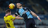 Paul Hayes of Wycombe Wanderers & John Lundstram of Oxford United go for the ball during the Sky Bet League 2 match between Wycombe Wanderers and Oxford United at Adams Park, High Wycombe, England on 19 December 2015. Photo by Andy Rowland.