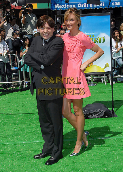 "MIKE MYERS & CAMERON DIAZ.attends The Dreamworks L.A. Premiere of ""Shrek The Third"" held at The Mann Village Theatre in Westwood, California, USA, May 06 2007..Full length pink coral dress hoop earrings black suit hand on hip.CAP/DVS.©Debbie VanStory/Capital Pictures"