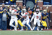 Ohio State Buckeyes defensive back Tyvis Powell (23) intercepts a two-point conversion meant for Michigan Wolverines wide receiver Drew Dileo (9) to clinch the win for the Buckeyes in the fourth quarter of the college football game between the Ohio State Buckeyes and the Michigan Wolverines at Michigan Stadium in Ann Arbor, Michigan, Saturday afternoon, November 30, 2013. The Ohio State Buckeyes defeated the Michigan Wolverines 42 - 41. (The Columbus Dispatch / Eamon Queeney)