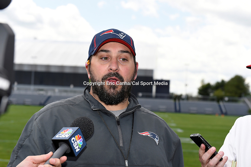 May 30, 2014 - Foxborough, Massachusetts, U.S. - New England Patriots defensive coordinator Matt Patricia take's questions from the media at the team's organized team activity at Gillette Stadium in Foxborough, Massachusetts. Eric Canha/CSM