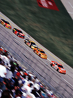 Tony Stewart leads early at Talladega dring the Winston 500 in October 200. (Photo by Brian Cleary)
