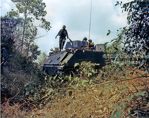 Long Binh, Vietnam - February 23, 1969 -- An M-113 Armored Personnel Carrier from First Squadron, 11th Armored Calvary, fights its way through dense undergrowth during a firefight..Credit: Kenneth L. Dowell - U.S. Army via CNP