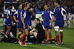 All Black Reuben Thorne crouches while the team awaits a referee's call during the first international rugby test at Eden Park, Auckland, New Zealand, Saturday, June 02, 2007. The All Blacks beat France 42-11.