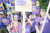 Supporters of Democratic presidential candidate and California senator Kamala Harris march in the 4th of July Parade in Amherst, New Hampshire, on Thu., July 4, 2019.