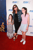 "LOS ANGELES - MAR 8:  Tiffani Thiessen, daughters at the Disney's ""Cinderella"" Advance Screening at the Disney Studios on March 8, 2015 in Burbank, CA"