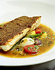 An encrusted sea bass entree at Chambers Kitchen, the restaurant at The Chambers Hotel in Minneapolis, Minnesota. Photo by Kevin J. Miyazaki/Redux