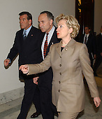 Washington, DC - March 20, 2002 -- United States Director of Homeland Security Tom Ridge, left, meets with U.S. Senator Hillary Rodham Clinton (Democrat of New York), right, in her Capitol Hill Office.  They were joined by U.S. Senator Chuck Schumer (Democrat of New York), center..Credit: Ron Sachs / CNP