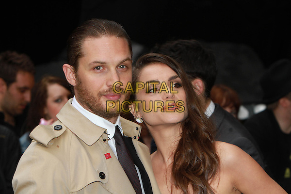 Tom Hardy and Charlotte Riley.'The Dark Knight Rises' European premiere at Odeon Leicester Square cinema, London, England..18th July 2012.headshot portrait beige trenchcoat black top strapless couple beard facial hair .CAP/ROS.©Steve Ross/Capital Pictures.