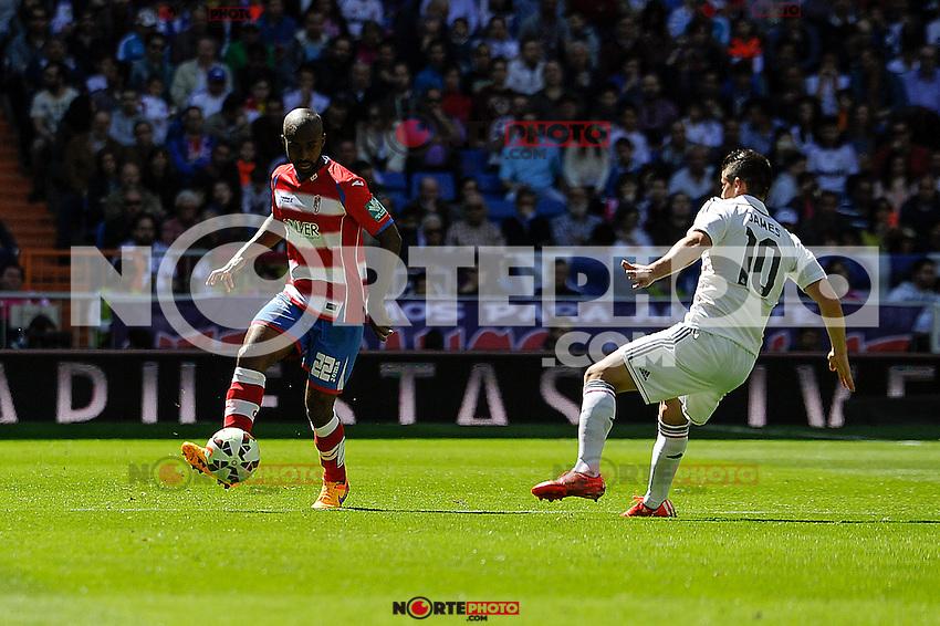 Real Madrid´s James Rodriguez and Granada´s Dimitri Foulquier during 2014-15 La Liga match between Real Madrid and Granada at Santiago Bernabeu stadium in Madrid, Spain. April 05, 2015. (ALTERPHOTOS/Luis Fernandez) /NORTEphoto.com