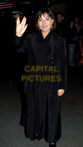 LORRAINE KELLY.Ref: 007.waving, hand, long black coat.www.capitalpictures.com.sales@capitalpictures.com.©  Capital Pictures.