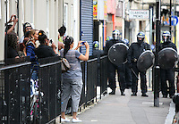 PH: Rick Findler..08.08.11 Residents take pictures as youths and police clash in Hackney today as riots spread across the whole of London including Croydon and Clapham.