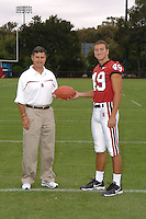 7 August 2006: Stanford Cardinal head coach Walt Harris and Tyler Porras during Stanford Football's Team Photo Day at Stanford Football's Practice Field in Stanford, CA.