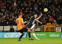 Newcastle United's Andy Carroll  Wolverhampton crosses the ball despite the attentions of Wanderers' Ruben Neves<br /> Photographer Lee Parker/CameraSport<br /> <br /> The Premier League - Wolverhampton Wanderers v Newcastle United - Saturday 11th January 2020 - Molineux - Wolverhampton<br /> <br /> World Copyright © 2020 CameraSport. All rights reserved. 43 Linden Ave. Countesthorpe. Leicester. England. LE8 5PG - Tel: +44 (0) 116 277 4147 - admin@camerasport.com - www.camerasport.com