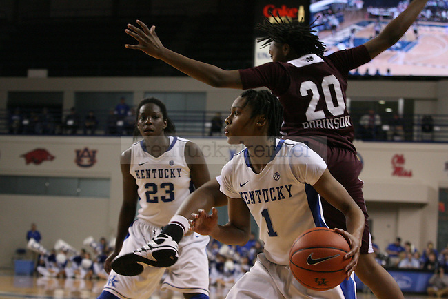 UK senior guard dodges past Mississippi State sophomore forward Shamia Robinson at Memorial Coliseum on Thursday, January 17, 2013 in Lexington, Ky.  Photo by Adam Pennavaria | Staff