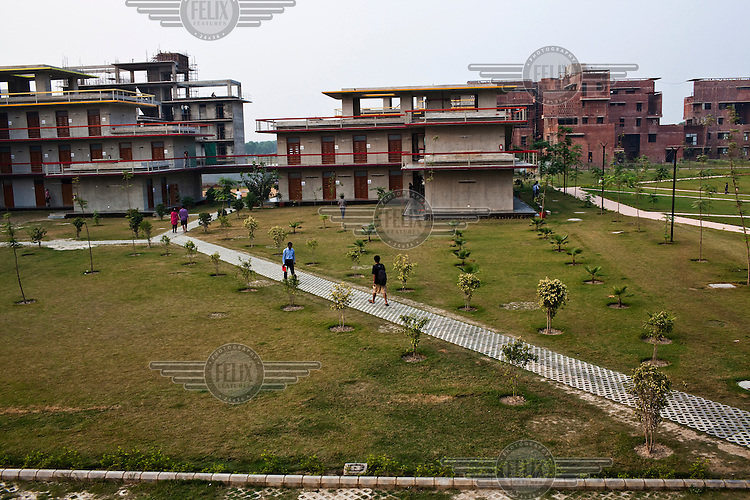 Students walk back to their hostel after classes at the Jindal Global University in Sonepat.