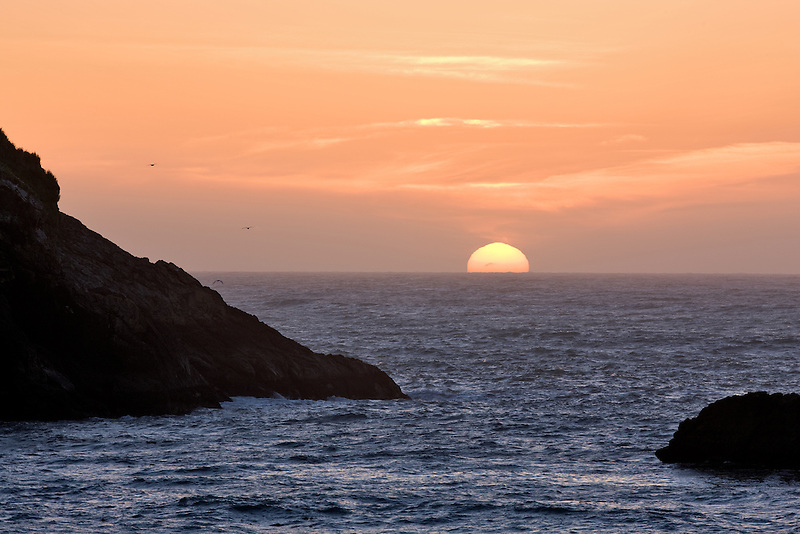 Sun setting at Harris Beach State Park, Oregon