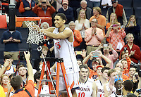 Virginia guard Malcolm Brogdon (15) cuts his piece of net to celebrate winning the ACC title after defeating Syracuse 75-56 Saturday March 1, 2014 during an NCAA basketball game in Charlottesville, VA.