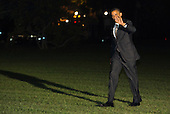 United States President Barack Obama waves to the photographers as he walks across the South Lawn of the White House in washington, D.C. after returning home from a series of campaign events across the country on October 25, 2012. .Credit: Kristoffer Tripplaar  / Pool via CNP
