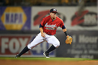 Mississippi Braves first baseman Kevin Ahrens (17) makes a diving stop during a game against the Pensacola Blue Wahoos on May 28, 2015 at Trustmark Park in Pearl, Mississippi.  Mississippi defeated Pensacola 4-2.  (Mike Janes/Four Seam Images)