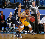 BROOKINGS, SD - DECEMBER 11:  Alexis Alexander #1 from South Dakota State University drives against Brianna Cummings #5 from George Washington during their game Sunday afternoon at Frost Arena in Brookings. (Photo by Dave Eggen/Inertia)