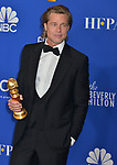 Brad Pitt 125 poses in the press room with awards at the 77th Annual Golden Globe Awards at The Beverly Hilton Hotel on January 05, 2020 in Beverly Hills, California.