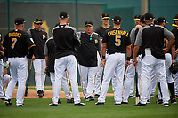 Pittsburgh Pirates coach Tom Prince (center) talks with the team, including Garth Brooks (7), Lonnie Chisenhall (5),  during the teams first Spring Training practice on February 18, 2019 at Pirate City in Bradenton, Florida.  (Mike Janes/Four Seam Images)