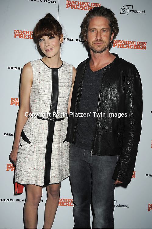 """Michelle Monaghan and Gerard Butler attending a special screening of """"Machine Gun Preacher"""" at the Museum of Modern Art on September 13, 2011 in New York City. The movie stars Gerard Butler and Michelle Monaghan.."""