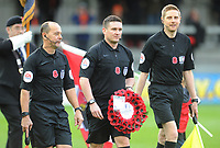 Referee Lee Collins leads the teams out carrying a wreath<br /> <br /> Photographer Kevin Barnes/CameraSport<br /> <br /> Emirates FA Cup First Round - Exeter City v Blackpool - Saturday 10th November 2018 - St James Park - Exeter<br />  <br /> World Copyright © 2018 CameraSport. All rights reserved. 43 Linden Ave. Countesthorpe. Leicester. England. LE8 5PG - Tel: +44 (0) 116 277 4147 - admin@camerasport.com - www.camerasport.com