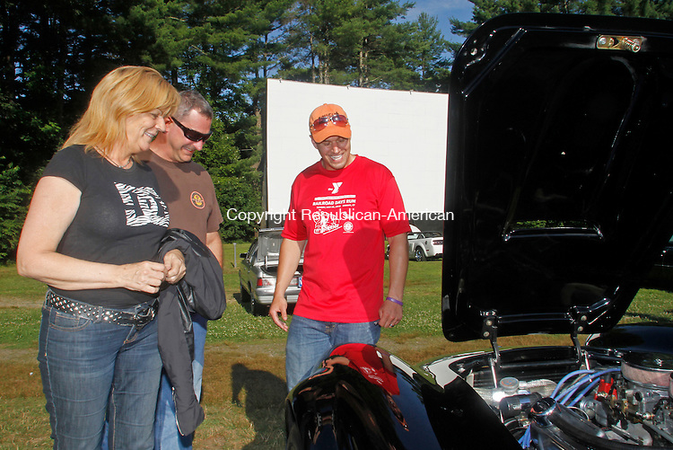 Barkhamsted, CT-072614MK02 Barkhamsted, CT From left Cindy Gamache, Mark Ferrigno talk to Mike Schieb about his 1965 Cobra during the Pleasant Valley drive-in theater vintage car show on Saturday afternoon in Barkhamsted. Donna McGrane, event coordinator said that over fifty cars participated and she anticipated that nearly six-hundred dollars were raised which will go towards defraying the cost of the $80,000 digital projector it had to buy this year to stay in business. Two more shows are scheduled; Saturday August 23 with a rain date of August 30th and September 20 with a rain date of September 27.  More information can be found at http://www. pvdrivein.com/carshows. Michael Kabelka / Republican-American
