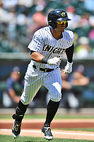 Charlotte Knights left fielder Jacob May (8) runs to first base during a game against the  Gwinnett Braves at BB&T Ballpark on May 7, 2017 in Charlotte, North Carolina. The Knights defeated the Braves 7-1. (Tony Farlow/Four Seam Images)
