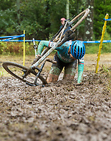 NWA Democrat-Gazette/BEN GOFF @NWABENGOFF<br /> Courtney Tanner of the United States falls while competing in the UCI Elite Women event Sunday, Oct. 6, 2019, during the the Fayettecross cyclocross races at Centennial Park at Millsap Mountain in Fayetteville.