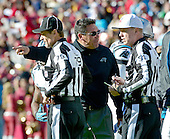Carolina Panthers head coach Ron Rivera has a discussion with head linesman Kent Payne (79) and referee Carl Cheffers (52) during a break in the action in the game against the Washington Redskins at FedEx Field in Landover, Maryland on Sunday, November 4, 2012.  The Panthers won the game 21 - 13..Credit: Ron Sachs / CNP