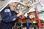 Pictured: Restoration volunteer Martin Marks polishes a lever in the Pinnace's engine room.<br /> <br /> An historic 100 year old Royal Navy steam ship has finally been returned to its former glory after a painstaking restoration process.<br /> <br /> The 50ft-long Steam Pinnace 199 is believed to be the last remaining boat of its type in operational service.<br /> <br /> For years, the significance of the boat, which was built in 1911, was lost on various owners and it languished at the side of the Thames for more than 20 years as a static houseboat.<br /> <br /> Her steam engine was even replaced by a petrol engine.<br /> <br /> However, before the vessel disappeared forever beneath a Thames mud bank, she was recognised for the proud little ship she once was and rescued by a group of volunteers, who called themselves Group 199.   SEE OUR COPY FOR DETAILS.<br /> <br /> © Morten Watkins/Solent News & Photo Agency<br /> UK +44 (0) 2380 458800